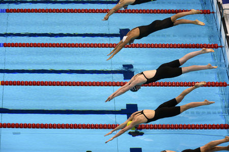 Missy Franklin of the United States, second from bottom, takes to the water at the start of the Women's 4x200 Meter Freestyle relay, in which the United States took the gold medal.
