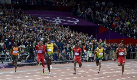 Usain Bolt of Jamaica pulls away to victory and a repeat gold medal in the Men's 100 Meter final at the London Olympics.