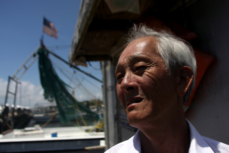 Bien Do, a shrimper who has made his living fishing in the Gulf for 30 years and who was hard hit by the BP oil spill, is shown on one of the two boats he owns in Pass Christian, Mississippi.