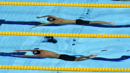 Michael Phelps and United States teammate, Ryan Lochte competing in the semifinals of the 200 meter individual medley during the 2012 London Olympics.  Phelps finished first in the event to take the gold medal, while Lochte was second with the silver.