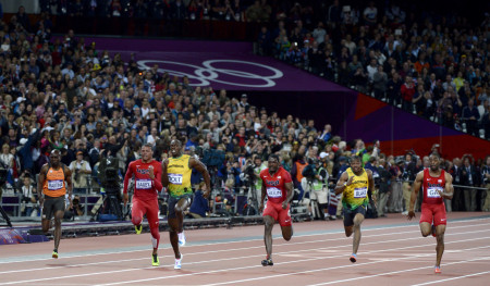 Usain Bolt of Jamaica pulls away to victory and a repeat gold medal in the Men's 100 Meter final at the 2012 London Olympics.