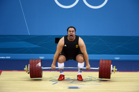 Almir Velagic of Germany attempting a lift in the Men's +105kg Weightlifting Competition.