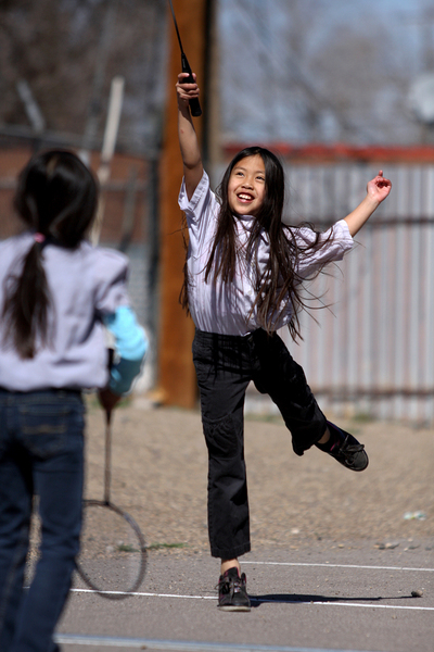 A young girl plays with friends during youth group activities at a Vietnamese temple in Albuquerque, New Mexico.