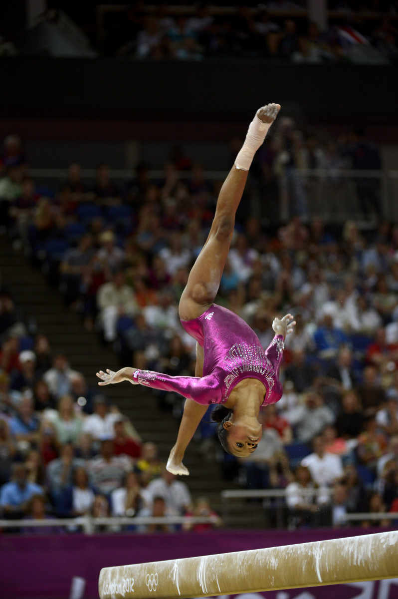 Gabrielle Douglas competing on the balance beam during the Gold Women's All Around Gymnastics competition, in which she took the gold medal.