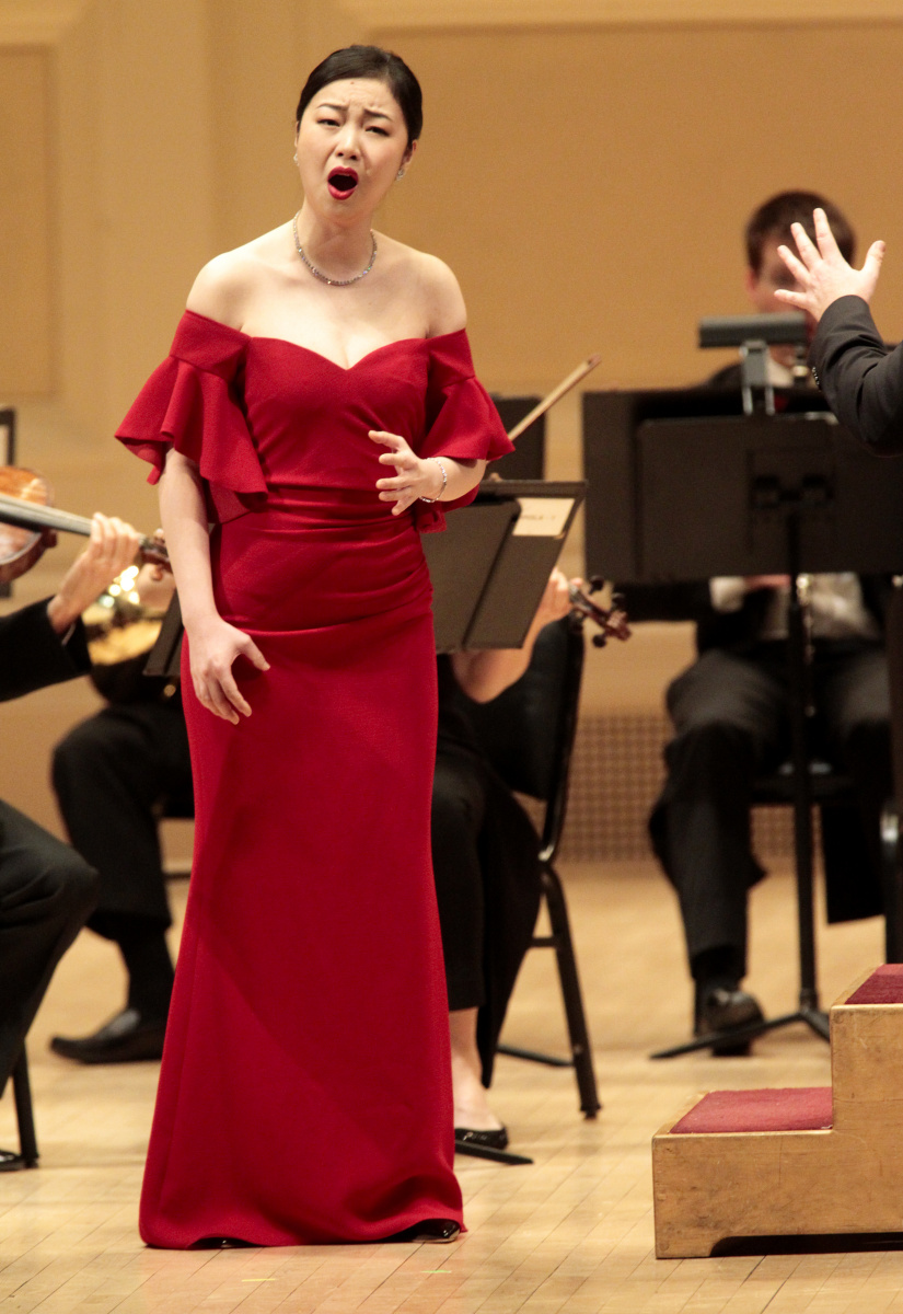 Soprano Ying Fang performing with the Orchestra of St. Lukes at Carnegie Hall.