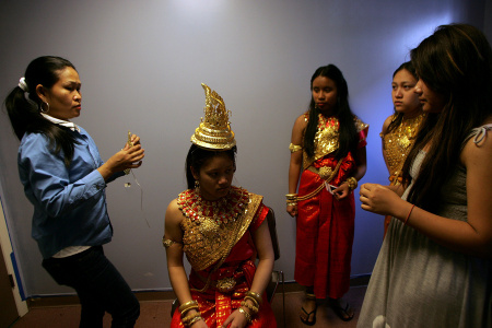 Teenagers getting ready to perform traditional Cambodian dances during a New Years celebration event at the Socio-Economic Development Center (SEDC) for