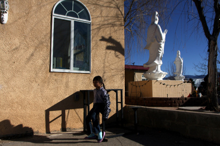 A young girl following youth services at the Van Hanh Buddhist Center in Albuquerque.