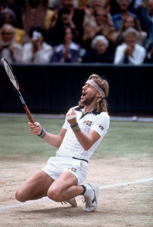 Bjorn Borg celebrating after defeating John McEnroe to win his fifth consecutive Wimbledon title in 1980.